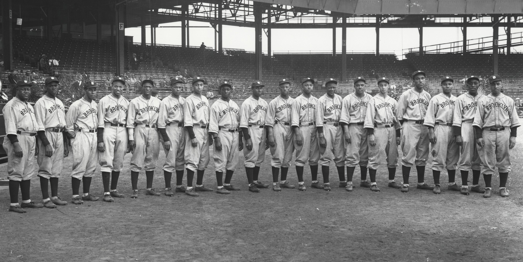 "A photograph of many black men in baseball uniforms reading ""Brooklyn"""