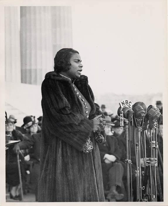 A black and white photograph of Marian Anderson singing.