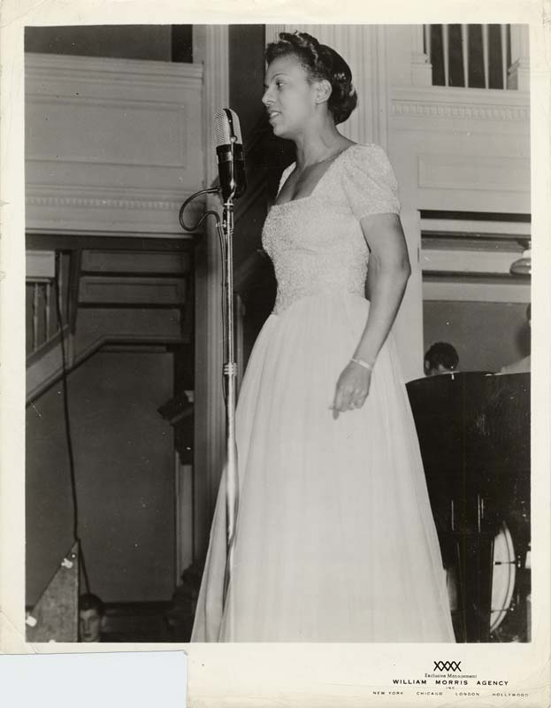 Woman singing at microphone