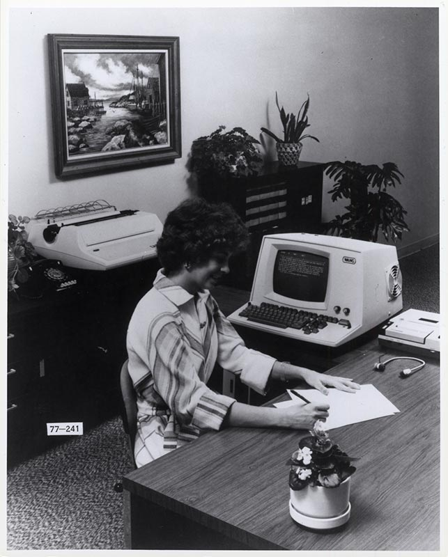 Woman at desk with computer