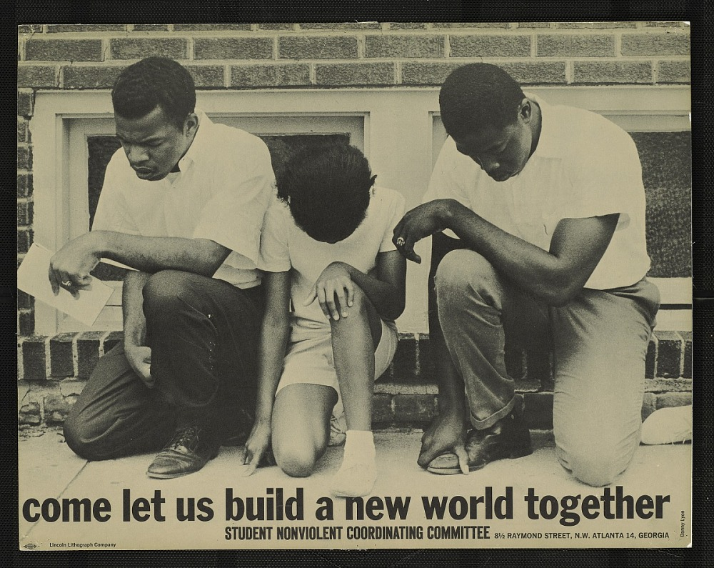 A poster showing John Lewis kneeling in prayer.