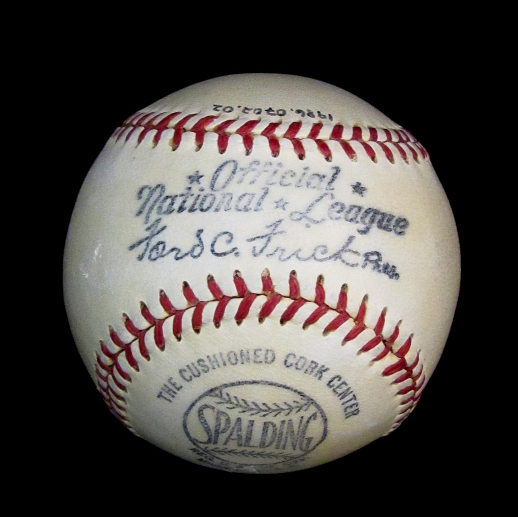 "A standard white baseball with red stitching. ""Official National League"" is imprinted on it."