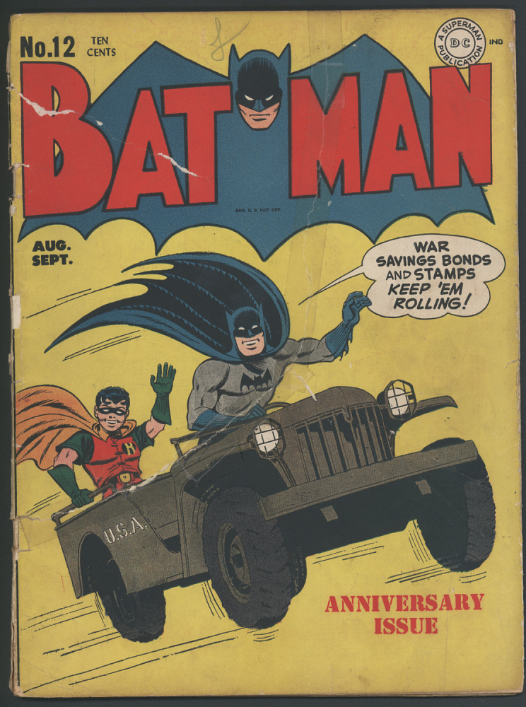 Batman and Robin ride in a jeep on the comic's cover.