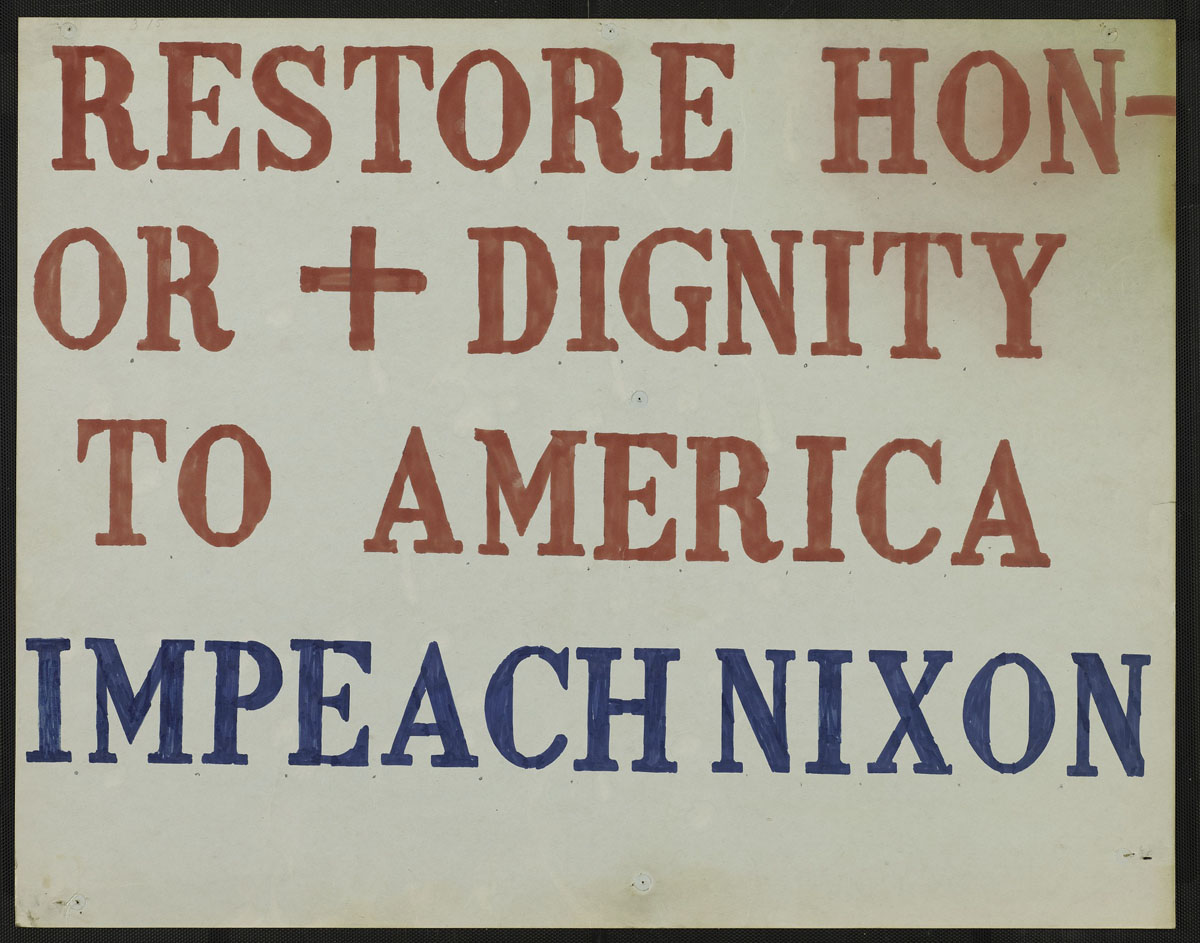 "A poster that reads ""Restore honor + dignity to America. Impeach Nixon."""