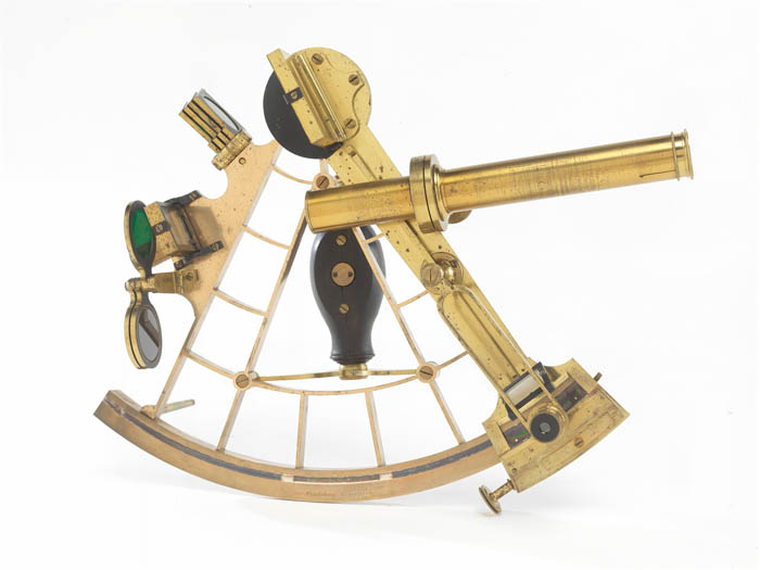 A golden sextant which is a quarter of a circle, with some knobs and devices, and a tube emerging perpendicular to it, ostensibly the telescope.