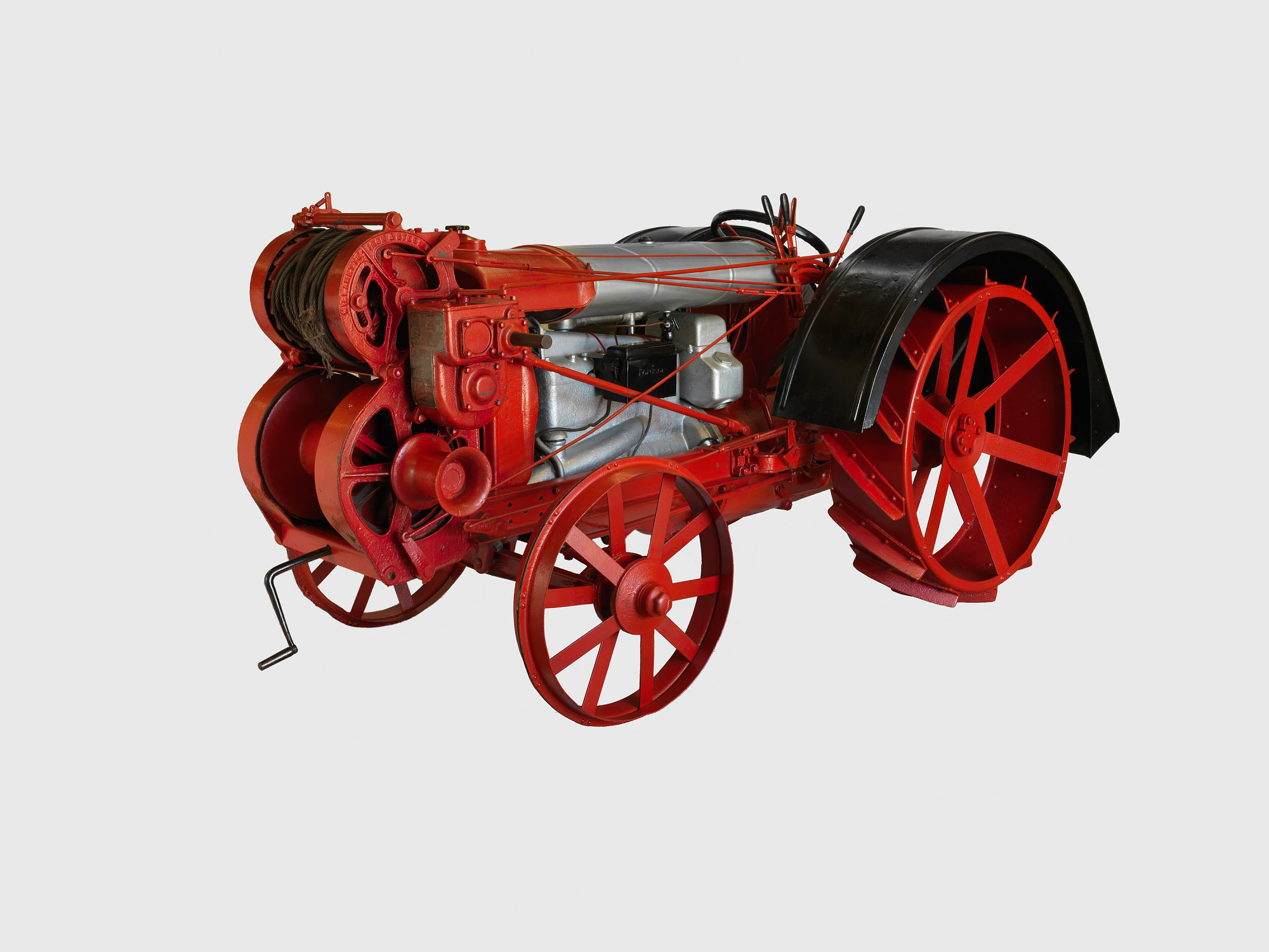 A red tractor, with a smaller front wheel and larger back wheel.