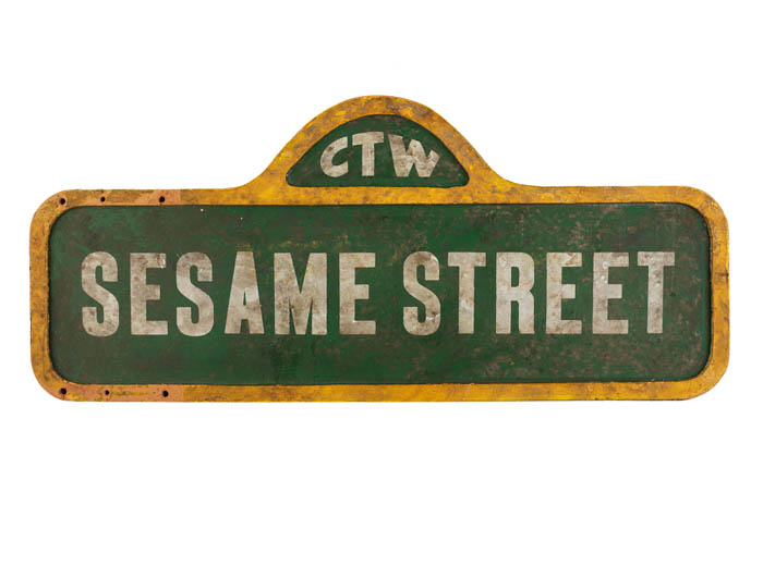 "A green and yellow text reading ""Sesame Street"""