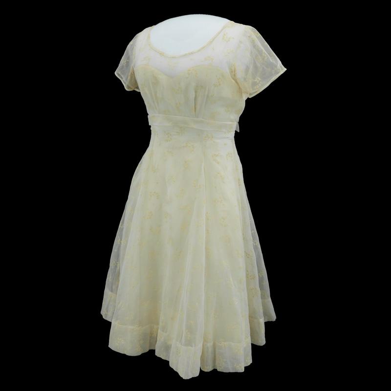 Minnijean Brown's white graduation dress
