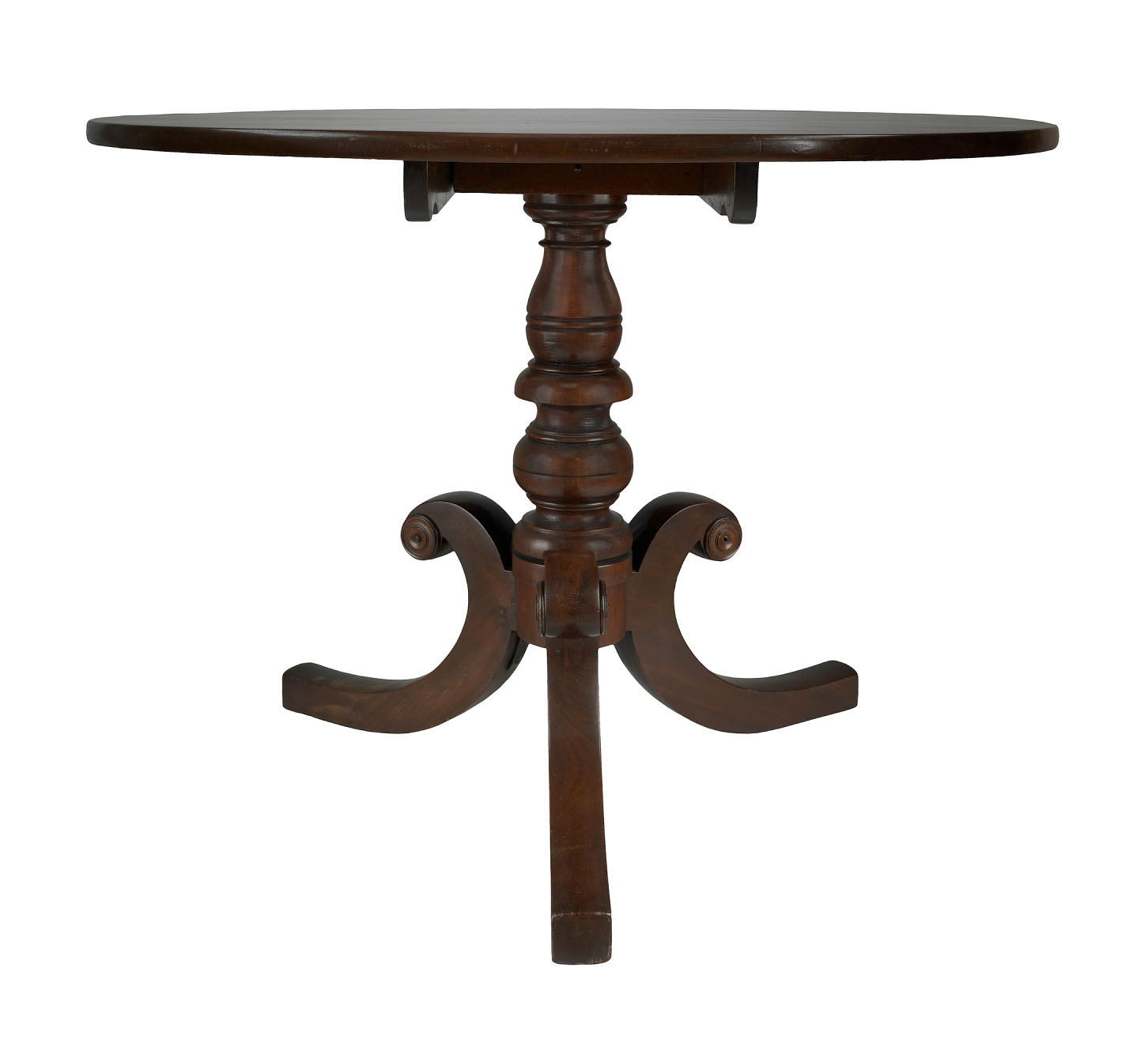 A wooden table, appears to be mahogany, with a rounded wooden top.