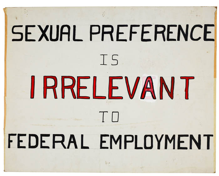 """A poster which reads """"Sexual preference is irrelevant to federal employment."""""""