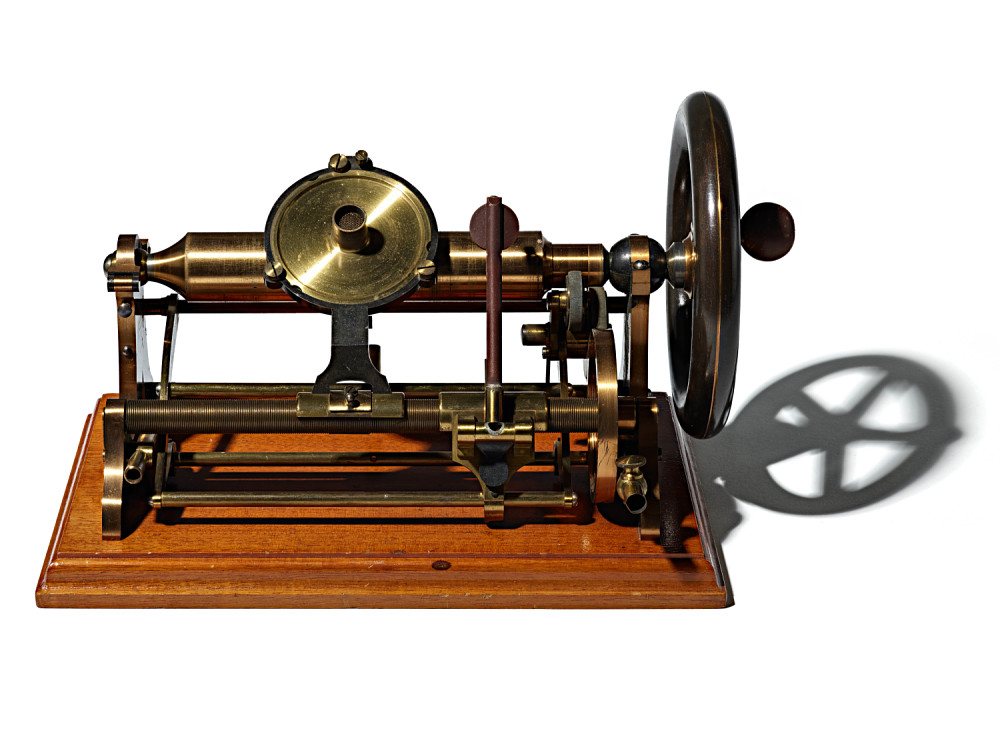 A machine with a rod, and a needle that allows you to play what is on a wax cylinder.