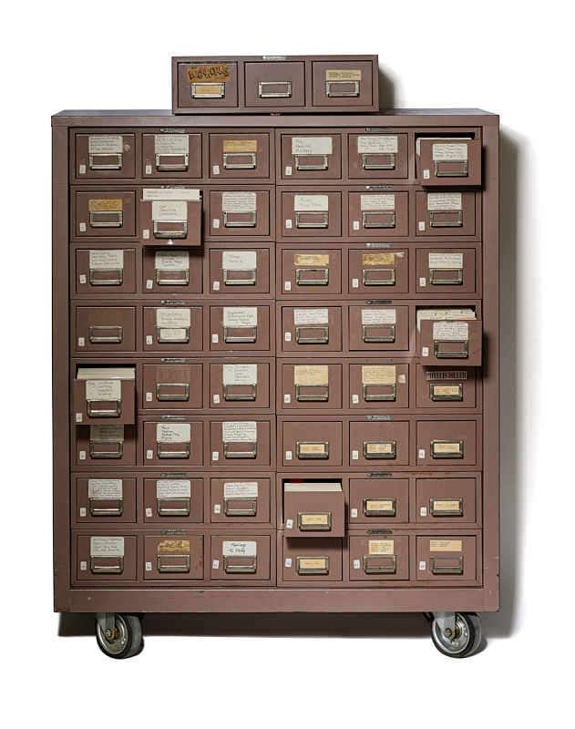 A card catalog file cabinet with jokes on index cards.
