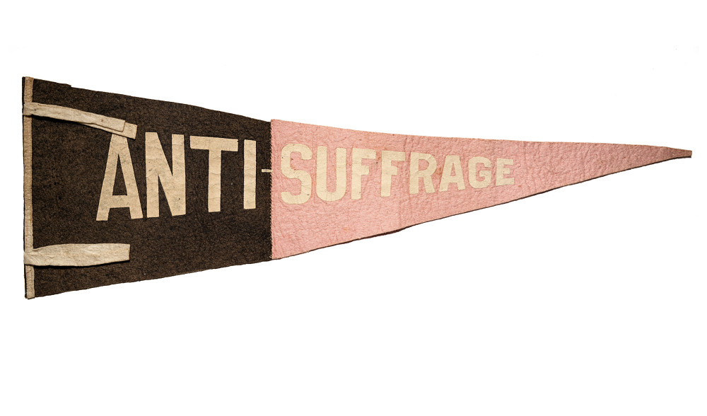 "A pink and black pennant that reads ""Anti-Suffrage."""