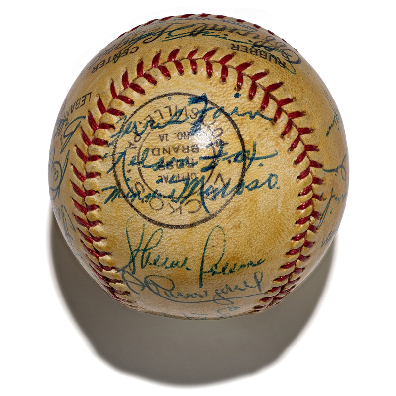 Yellowed baseball signed by members of the 1953 White Sox