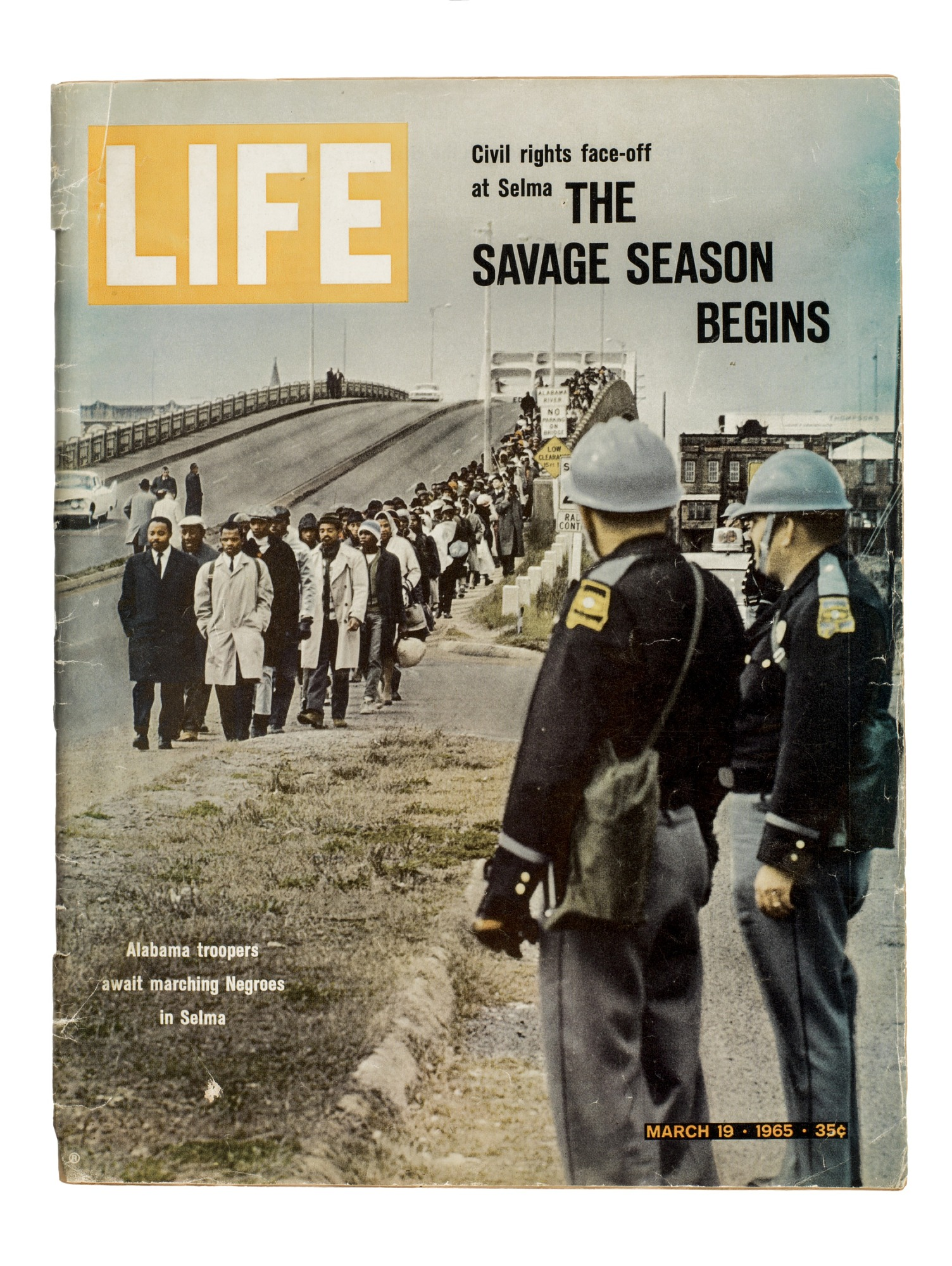 A Life Magazine cover showing protesters marching in Selma, led by John Lewis.