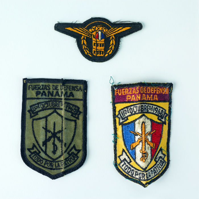 Three embroidered patches.