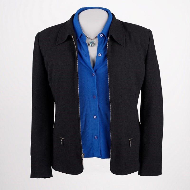Black suit jacket, blue blouse, and a necklace