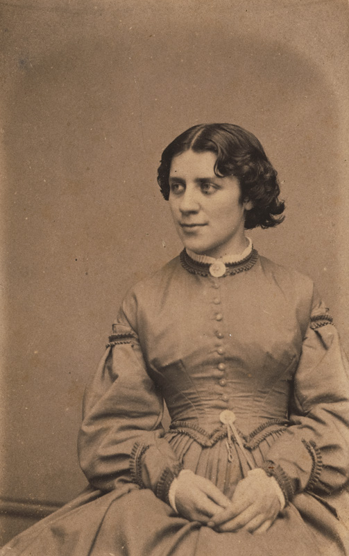 Anna Dickinson in her twenties, seated
