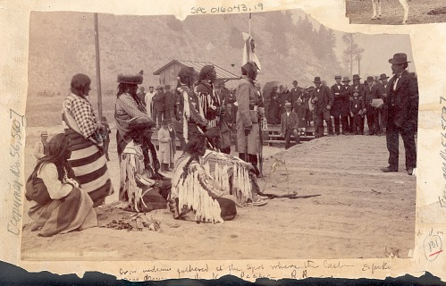 A photograph which features a group of Indigenous people at a ceremony.