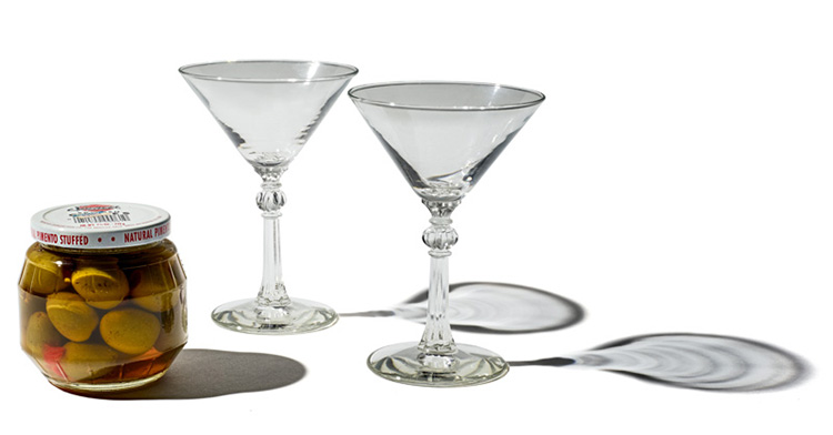 Two martini glasses and jar of olives