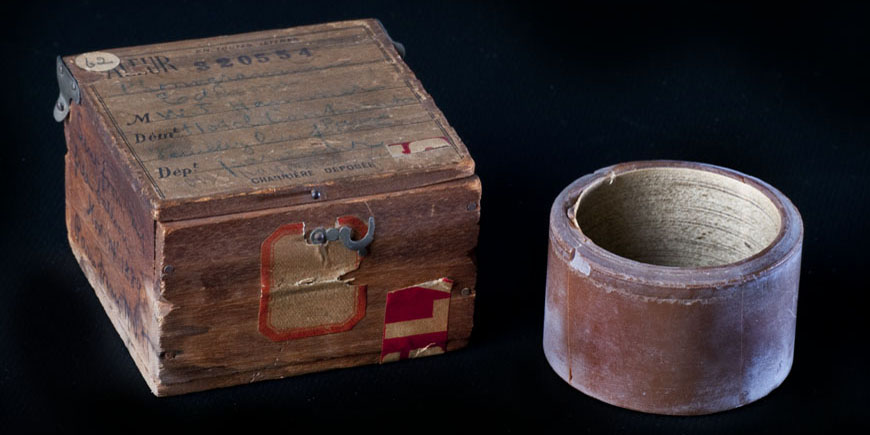 A small box and a round cylinder.