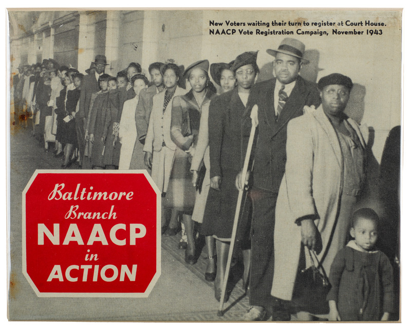 A line of people stand outside the NAACP office in Baltimore, waiting to register to vote