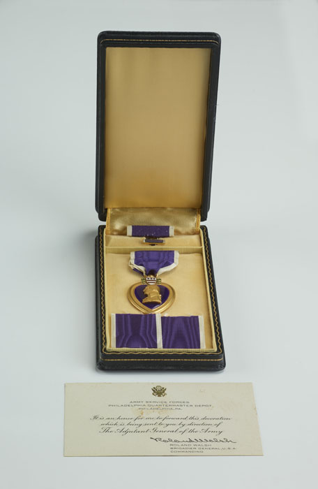 A Purple Heart medal in a box.