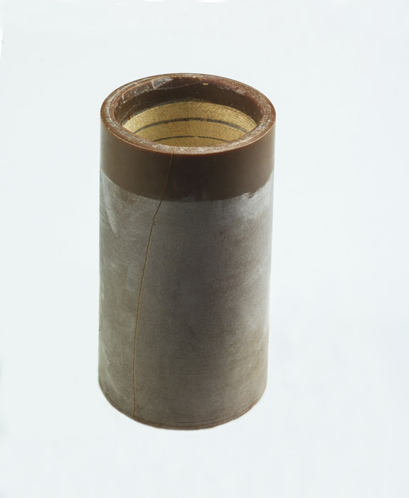 A cylinder with grooves.