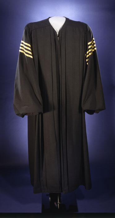 A robe with gold stripes on the sleeves.