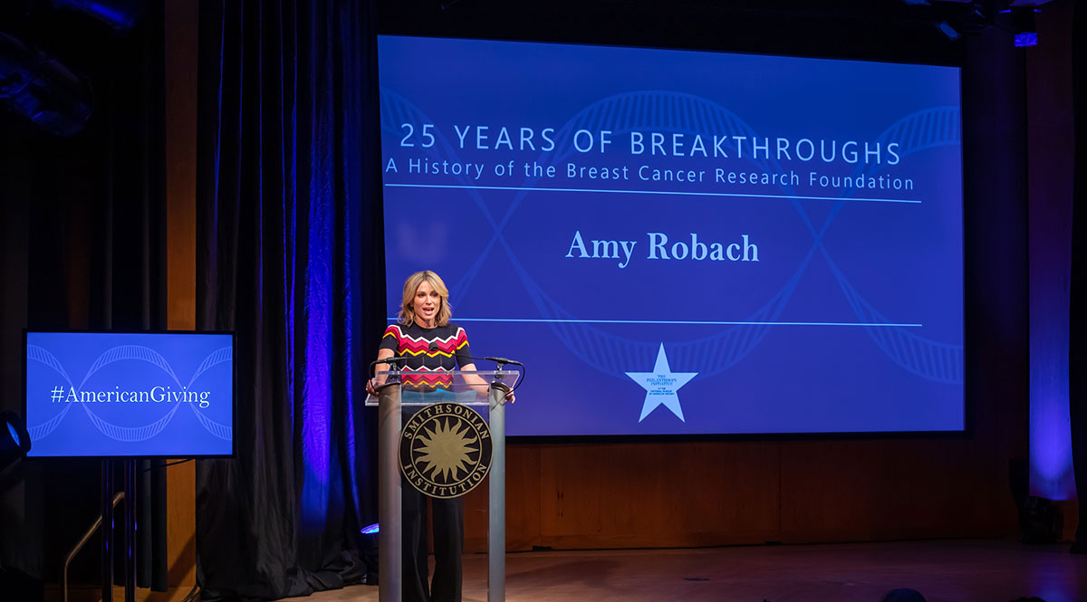 Caption: Journalist Amy Robach speaking at the 2019 Power of Giving symposium focusing on philanthropy's impact on health and medicine