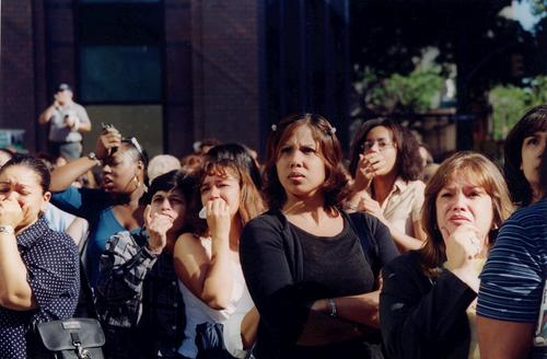 Bystanders stand in shock outside the World Trade Center.