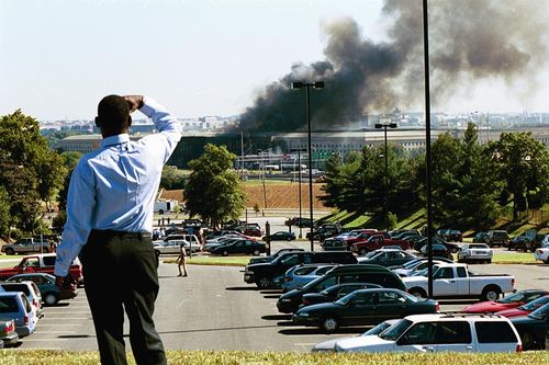 A man watches the crash at the Pentagon.