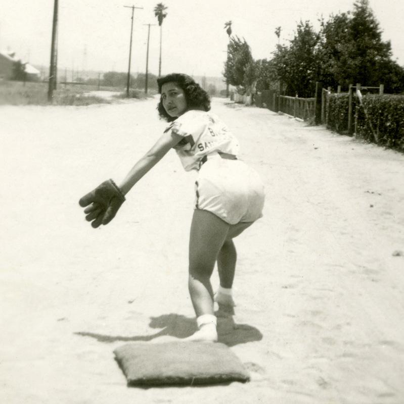 Señoritas player Carmen Lujan poses on a base, glove raised