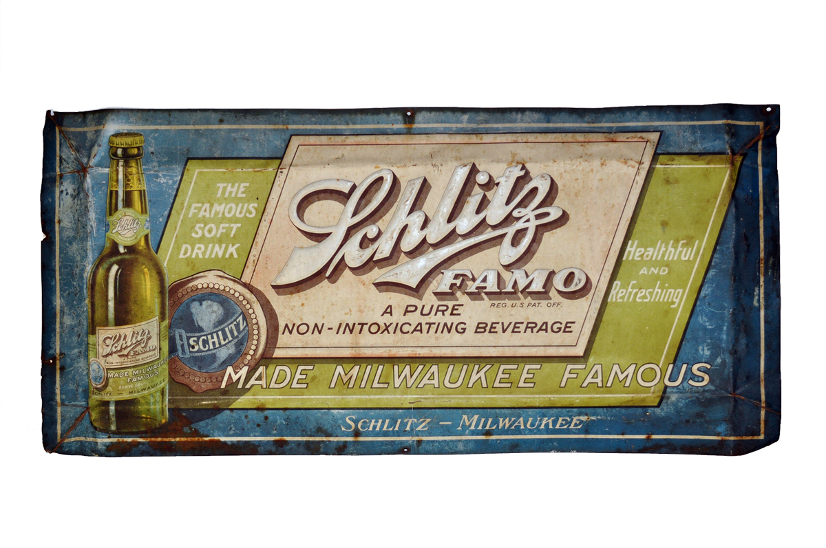"A sign for Schlitz Famo, a metal sign for the ""famous soft drink."""