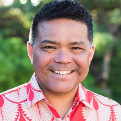 A man in a tropical shirt.