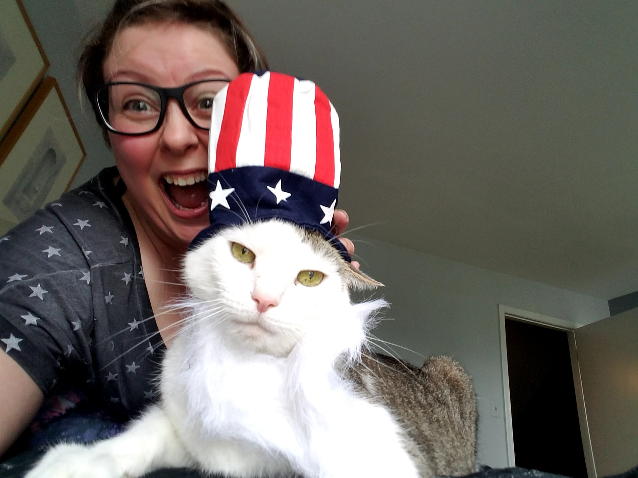The author and her cat, Shemp. The author is ecstatic. The cat, who wears an Uncle Sam hat, is less so.
