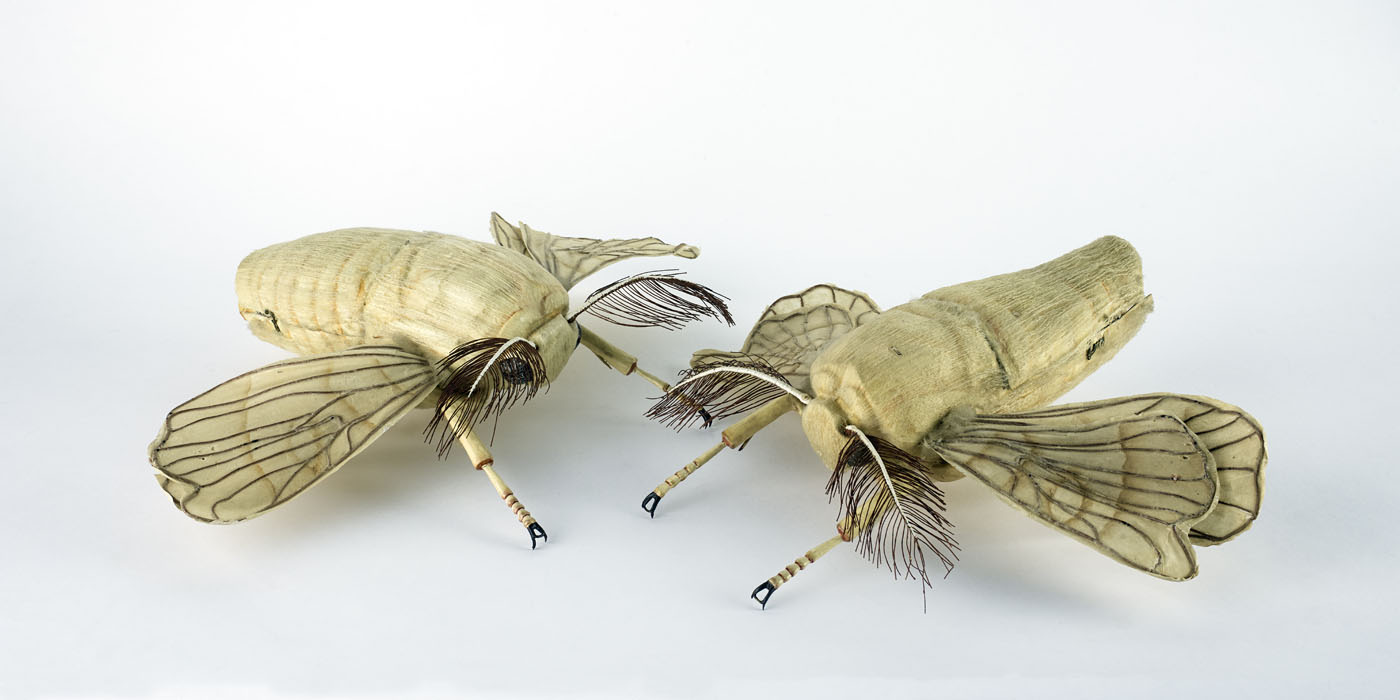 Large models of white moths.