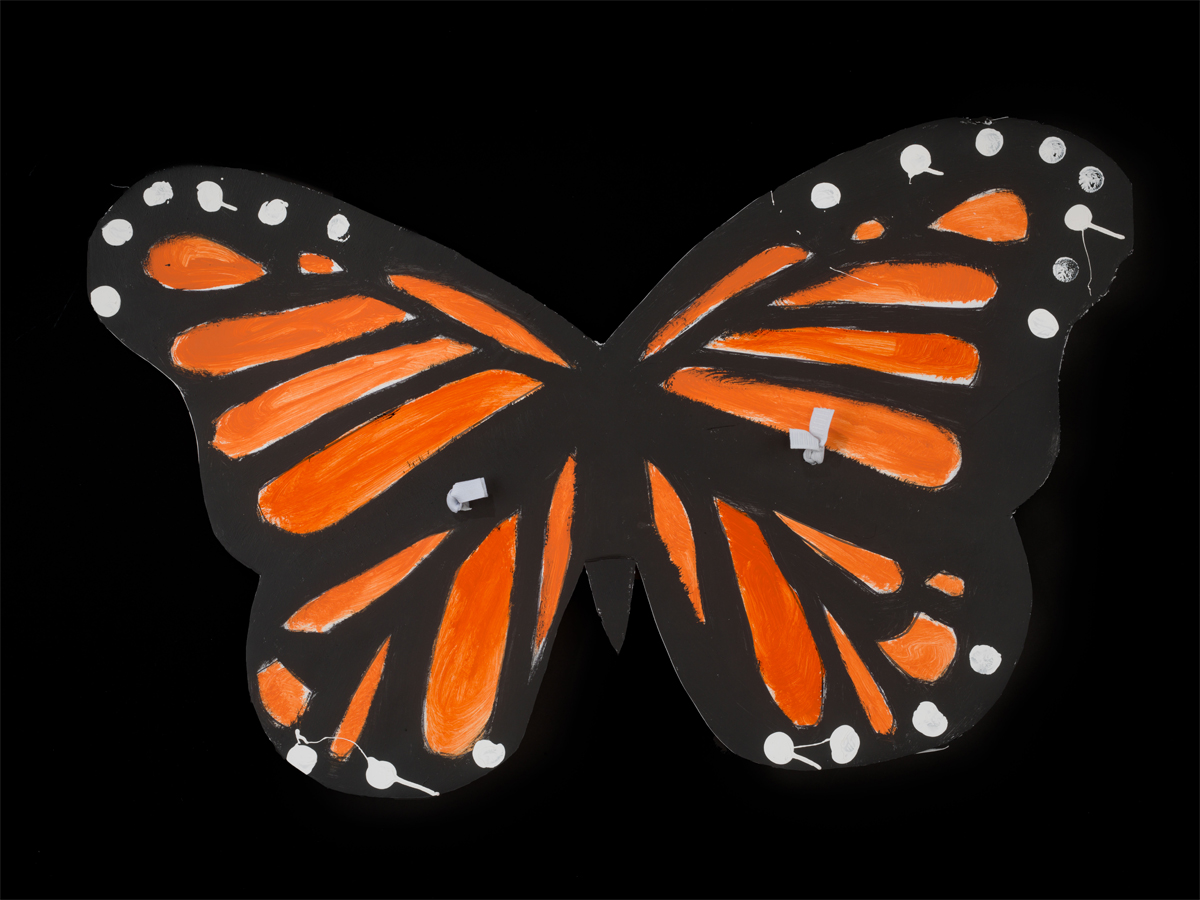 Orange and black monarch butterfly wings made of cardboard.