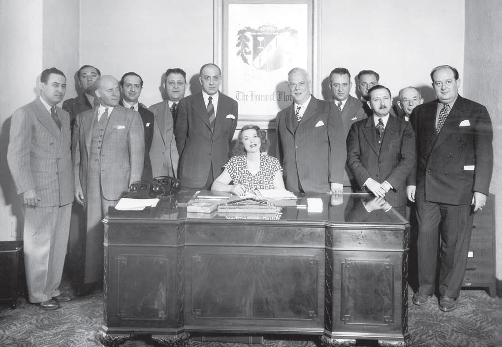 Tillie Lewis at desk