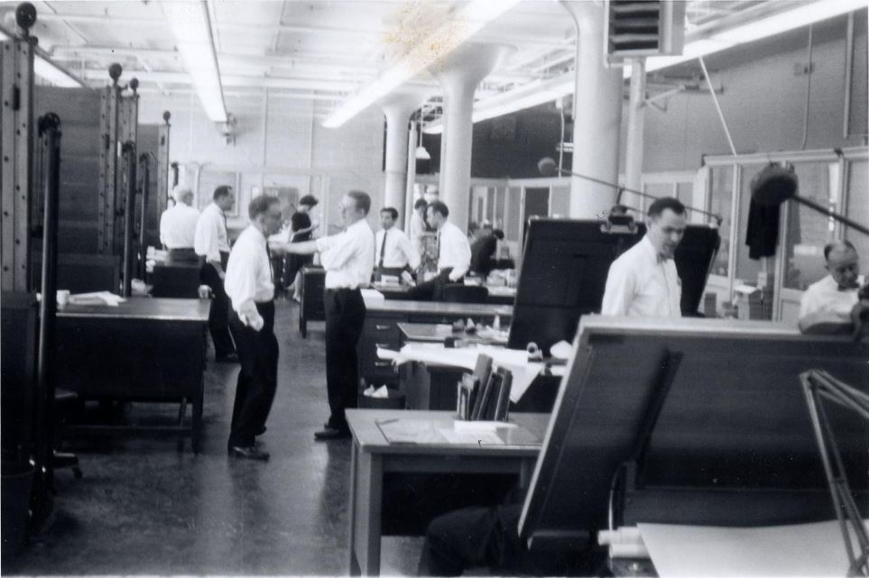 Workers in white button ups and ties at the United Shoe Machinery Company.