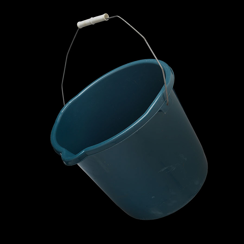 A blue mop bucket suspended in air as though pouring.