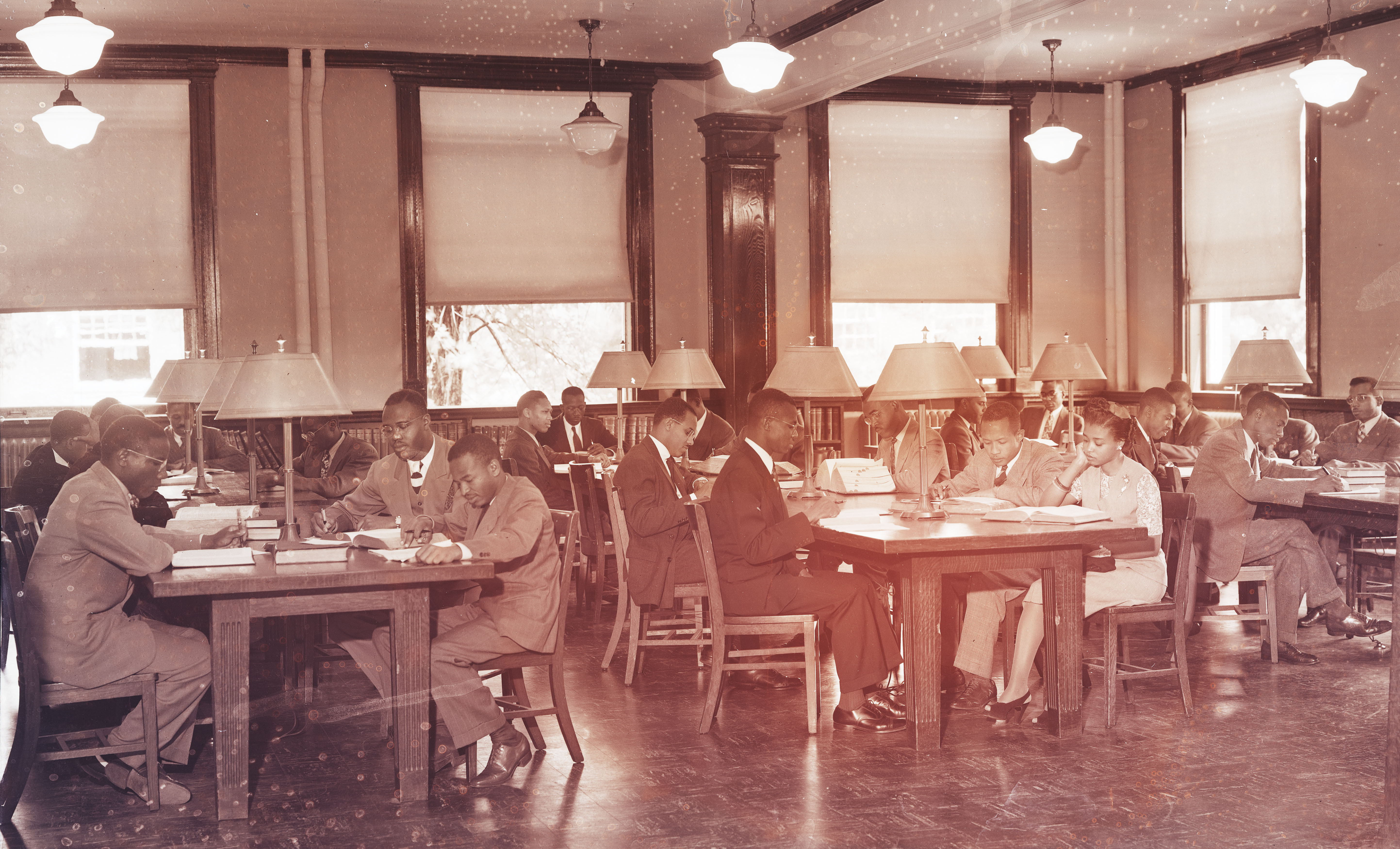 Photograph of young people at work at library desks