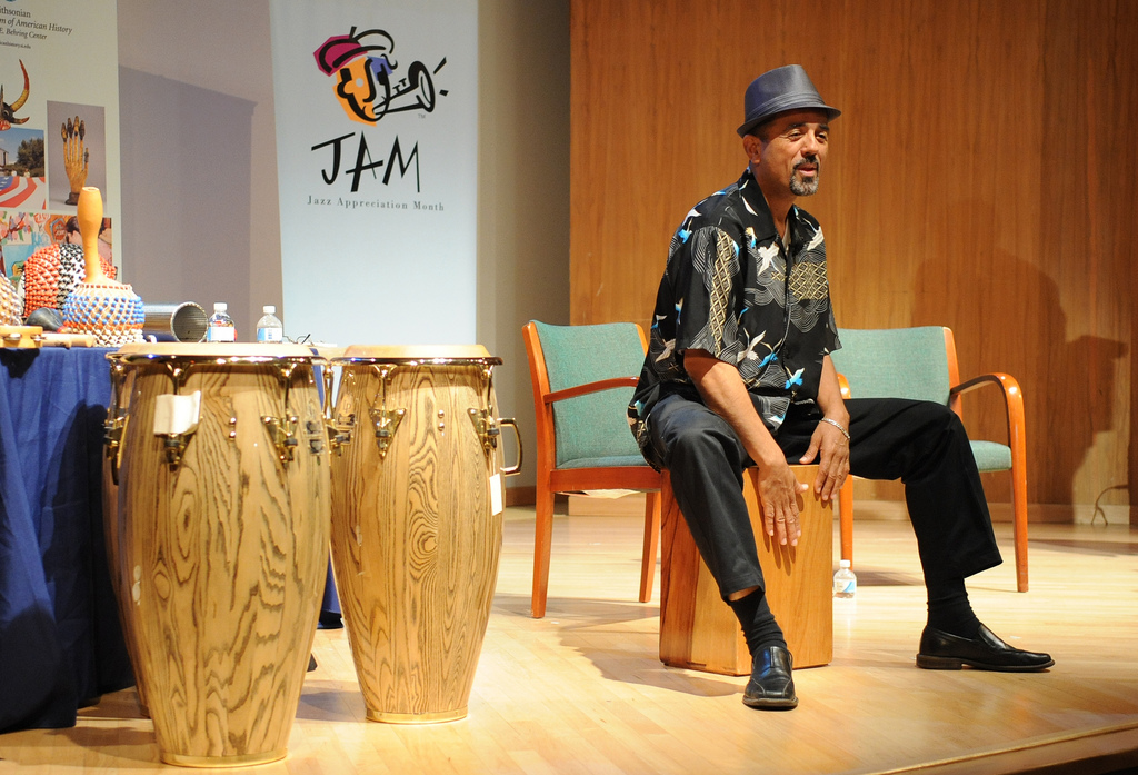 Percussionist onstage demonstrating playing techniques