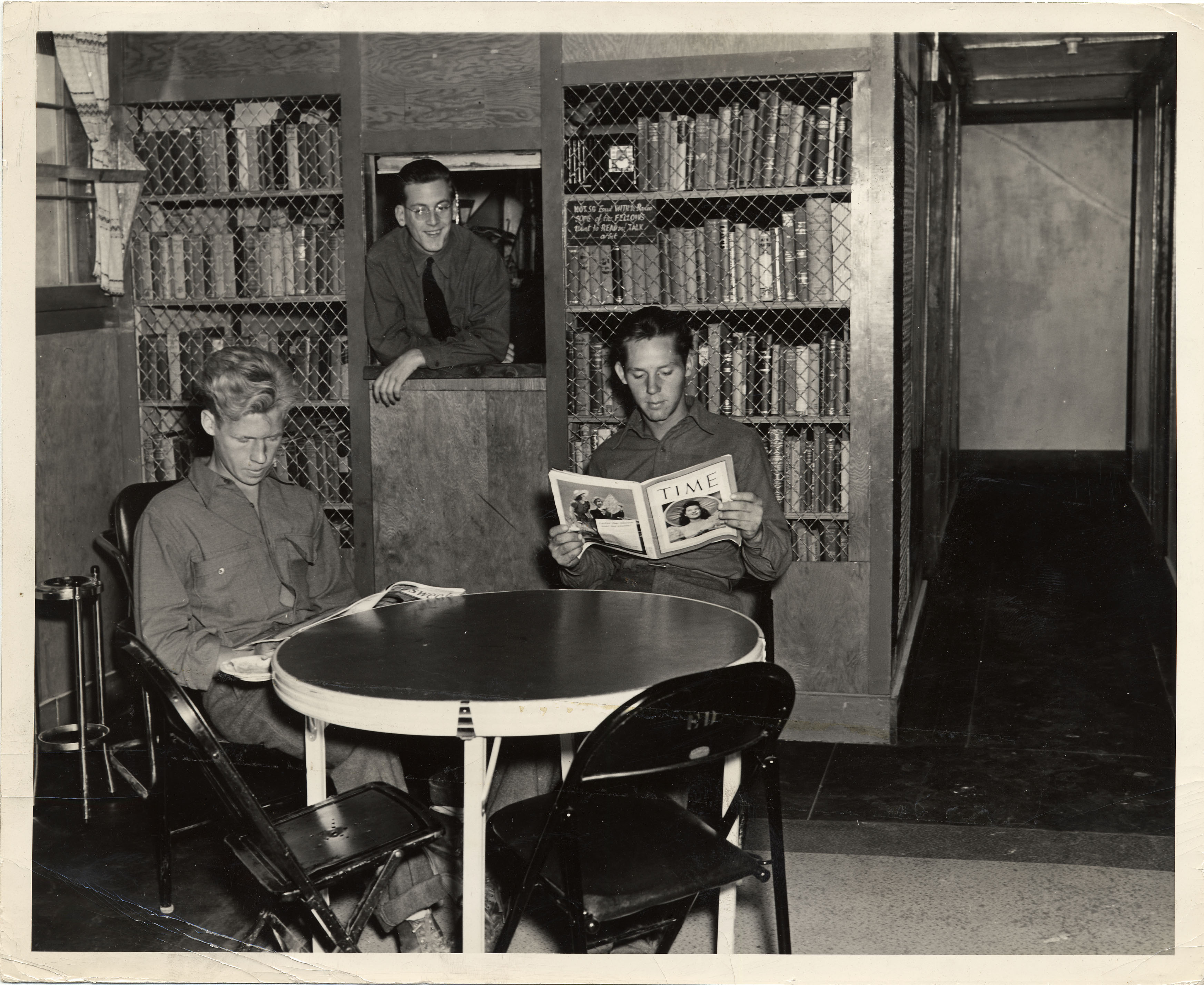 Men at Civilian Conservation Corps camp library in Utah.