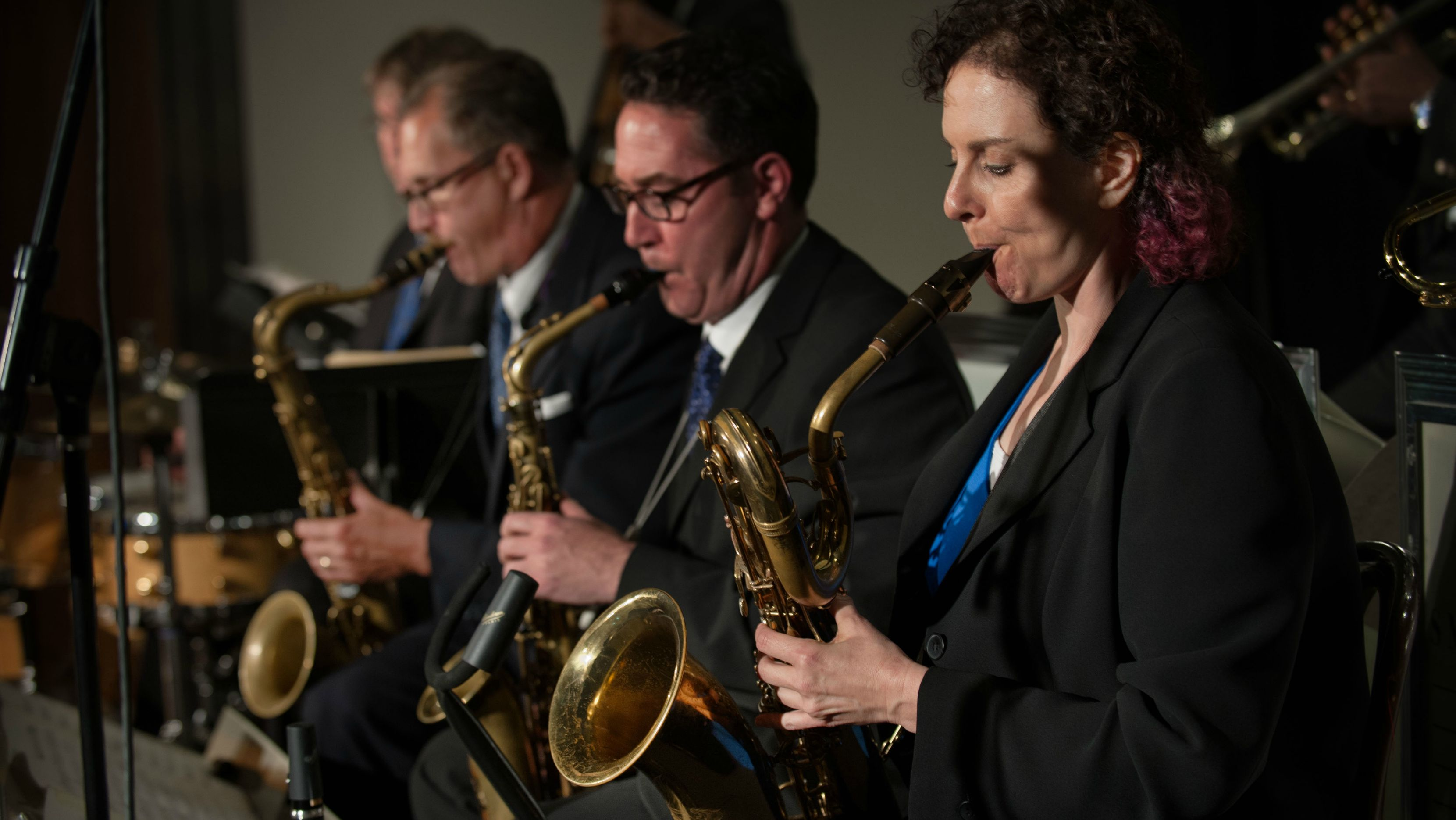 Four saxophonists