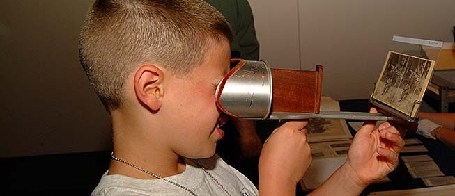 Boy enjoying stereo viewer at the Museum