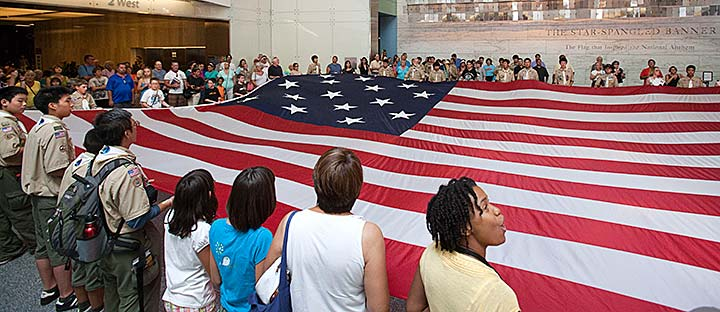Museum visitors during a flag-folding program