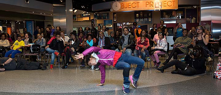 Woman hip hop dancing in front of a crowd
