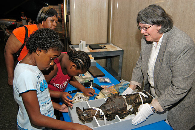 Children participating in a hands-on objects educational activity at the Museum