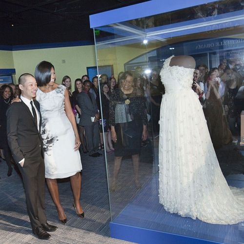 Designer Jason Wu and First Lady Michelle Obama view her newly donated gown in the First Ladies exhibition